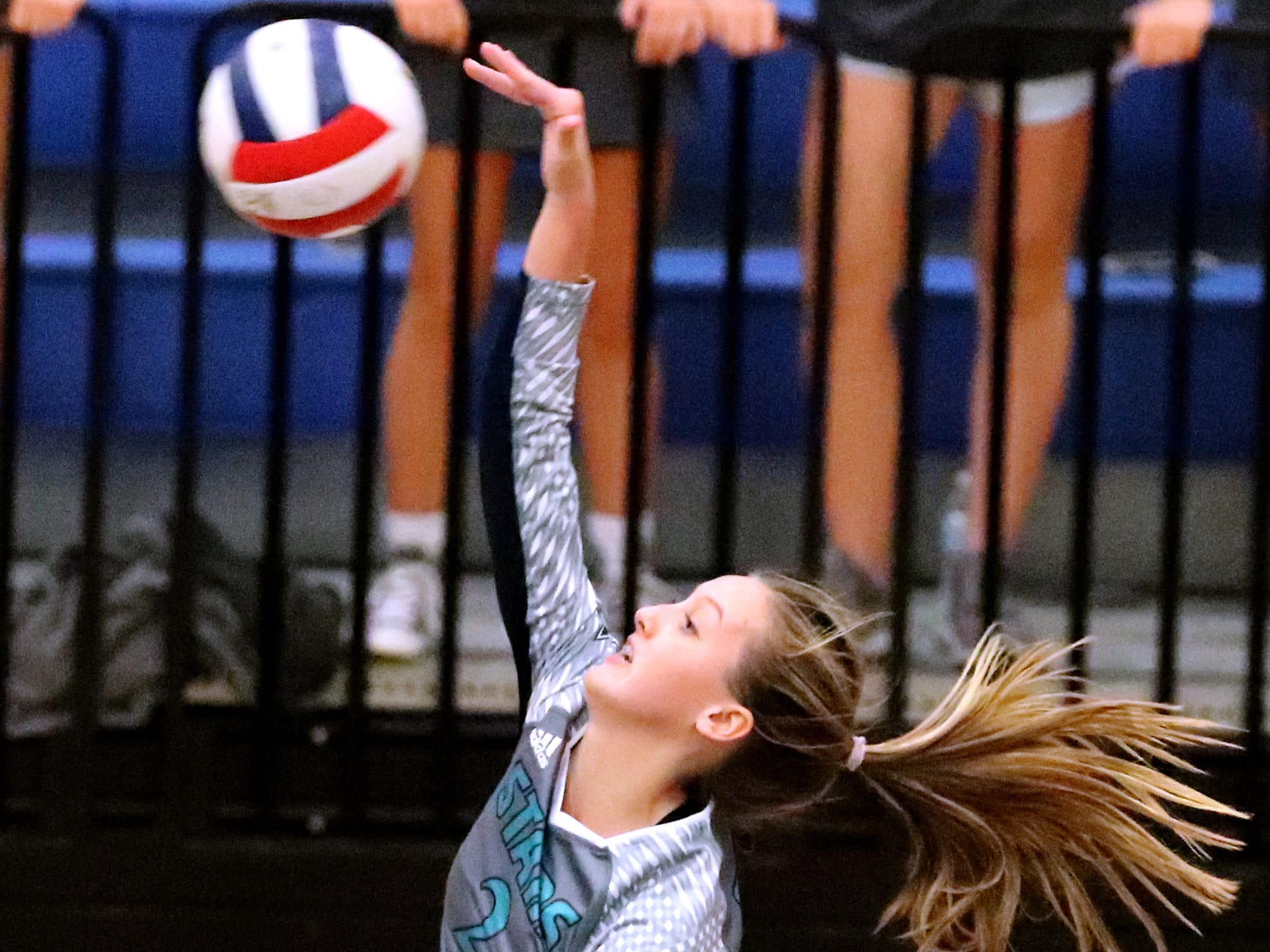 Siegel's Emily Wessner (2) hits the ball over the net during the Class AAA sectional against Cleveland Thursday, Oct. 11, 2018. Siegel beat Cleveland to advance to the State Championship tournament.