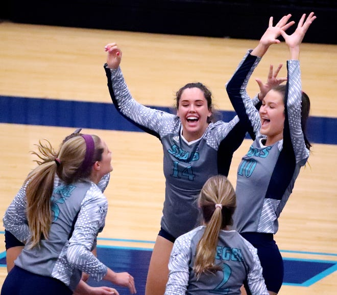 Siegel players celebrate a point over Cleveland in the Class AAA sectional Thursday.