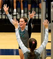 Siegel's Sydney Taylor (14) celebrates a point over Cleveland in the Class AAA sectional Thursday, Oct. 11, 2018, at Siegel.