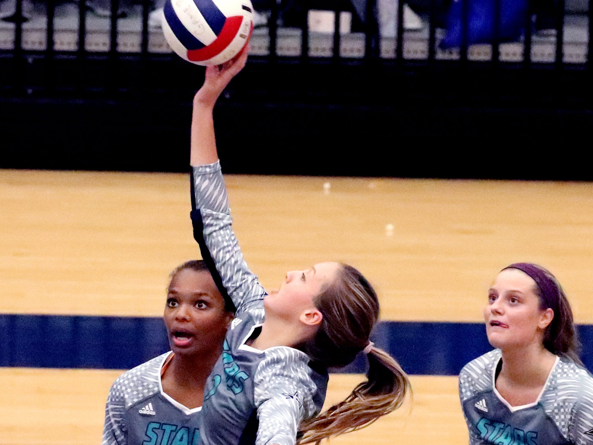 Siegel's Emily Phillips (2) hits the ball over the net during the Class AAA sectional against Cleveland Thursday, Oct. 11, 2018. Siegel beat Cleveland to advance to the State Championship tournament.