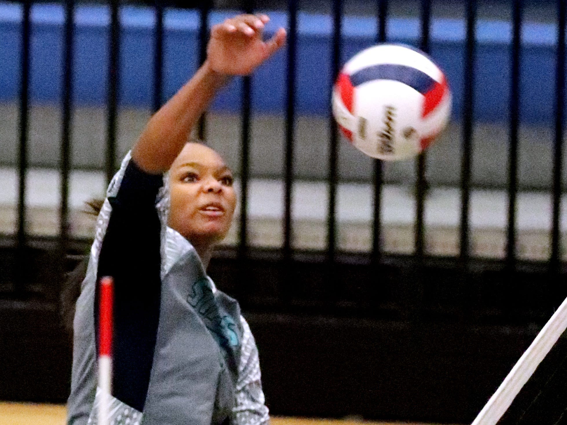 Siegel's Jaida Clark (7) hits the ball over the net during the Class AAA sectional against Cleveland Thursday, Oct. 11, 2018. Siegel beat Cleveland to advance to the State Championship tournament.