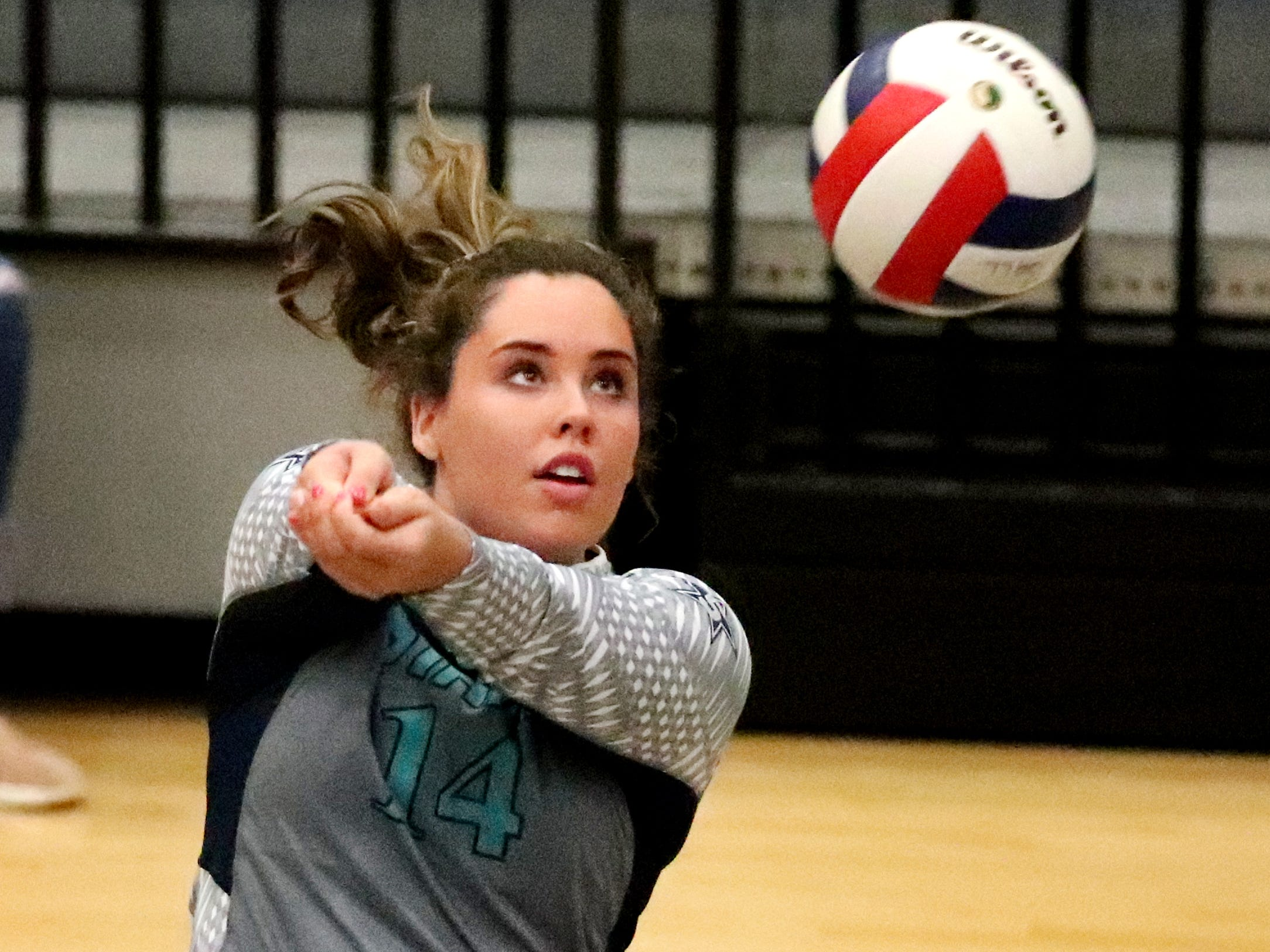 Siegel's Sydney Taylor (14) hits the ball during the Class AAA sectional against Cleveland Thursday, Oct. 11, 2018. Siegel beat Cleveland to advance to the State Championship tournament.