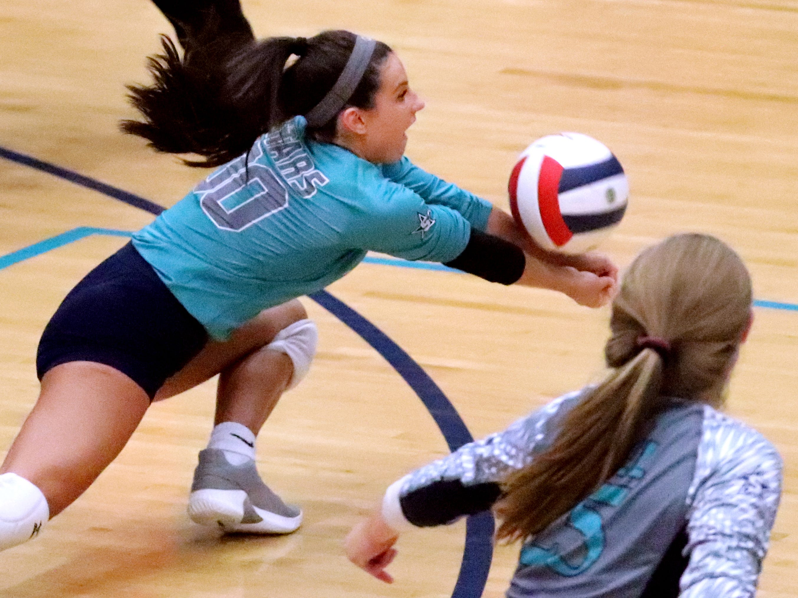 Siegel's Julia Poarch (00) bumps the ball during the Class AAA sectional against Cleveland Thursday, Oct. 11, 2018. Siegel beat Cleveland to advance to the State Championship tournament.