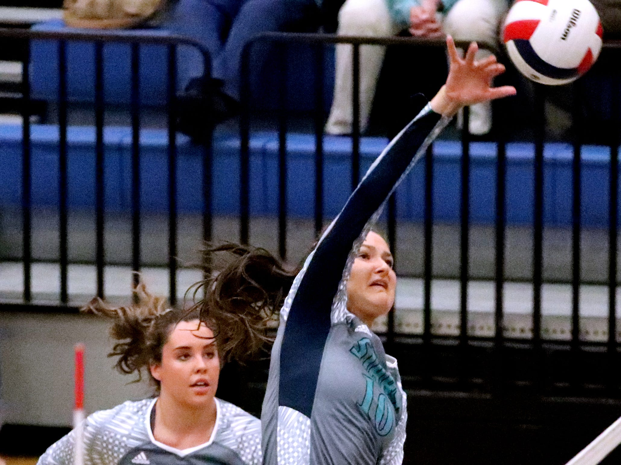 Siegel's Grace Reidmiller 10) hits the ball over the net during the Class AAA sectional against Cleveland Thursday, Oct. 11, 2018. Siegel beat Cleveland to advance to the State Championship tournament.