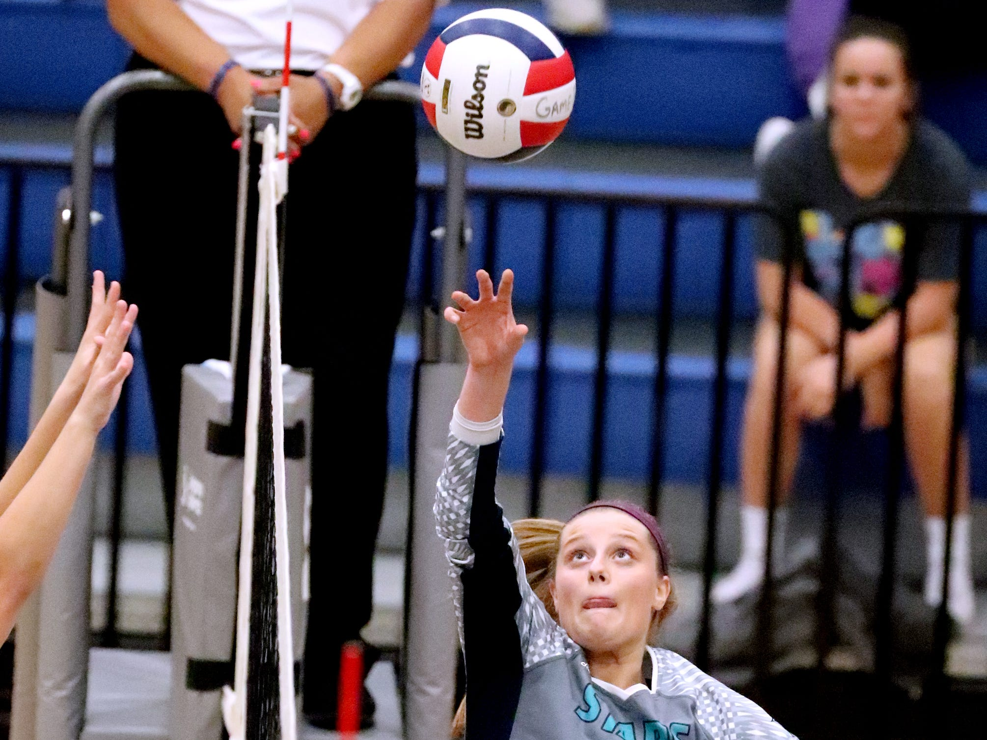 Siegel's Sophia Bossong (25) hits the ball over the net during the Class AAA sectional against Cleveland Thursday, Oct. 11, 2018. Siegel beat Cleveland to advance to the State Championship tournament.