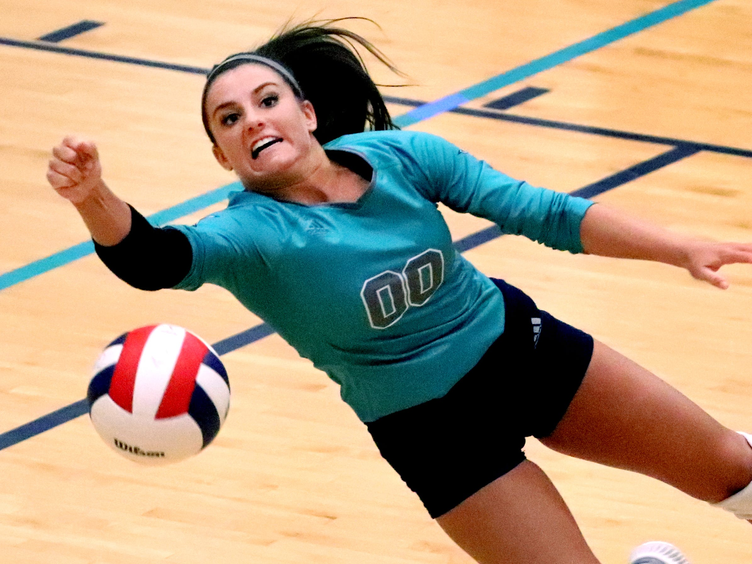 Siegel's Julia Poarch (00) goes after the ball during the Class AAA sectional against Cleveland Thursday, Oct. 11, 2018. Siegel beat Cleveland to advance to the State Championship tournament.