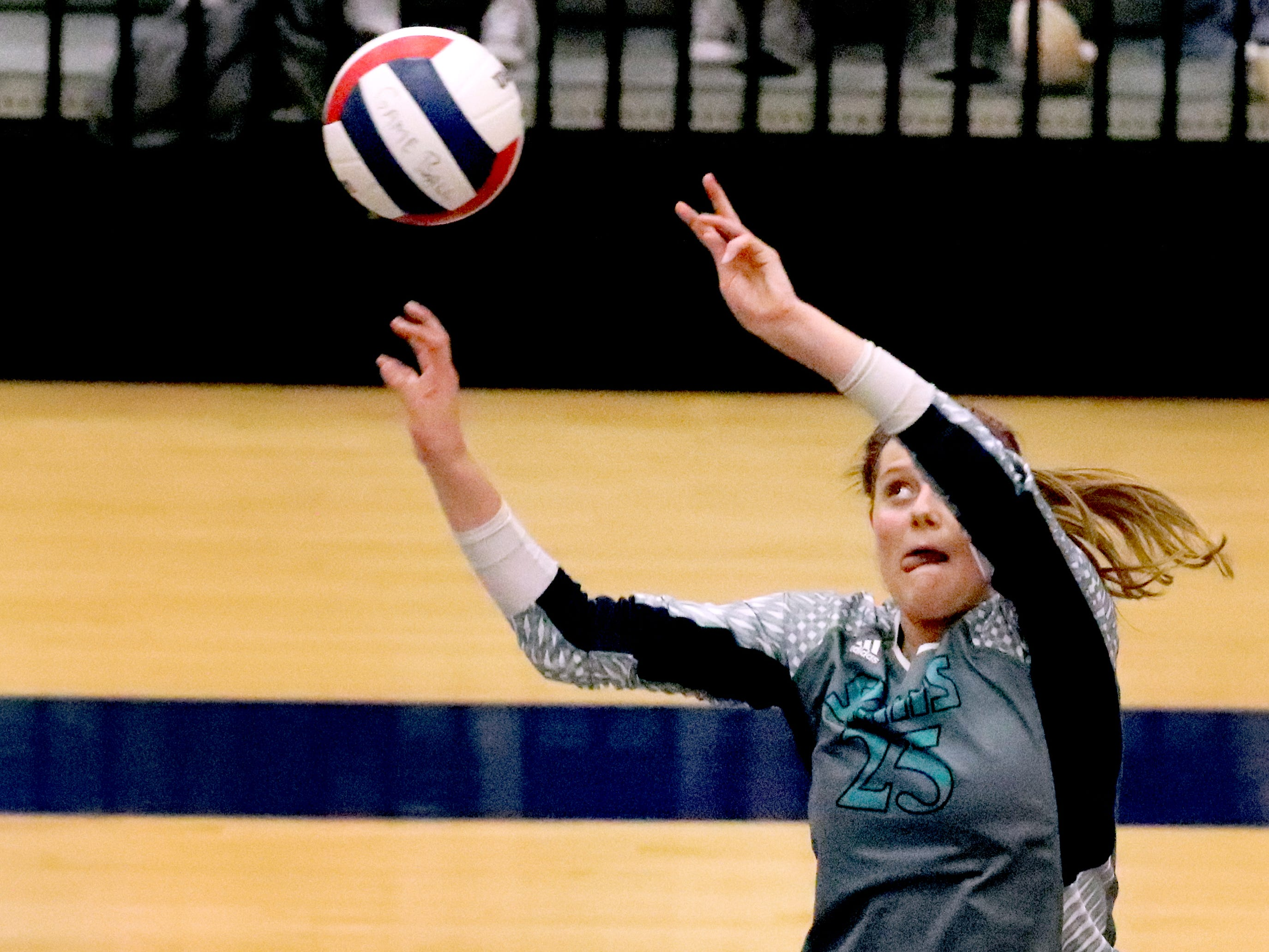 Siegel's Sophia Bossong (25) hits the ball over the net to win their first set at Cleveland during the Class AAA sectional Thursday, Oct. 11, 2018. Siegel beat Cleveland to advance to the State Championship tournament.