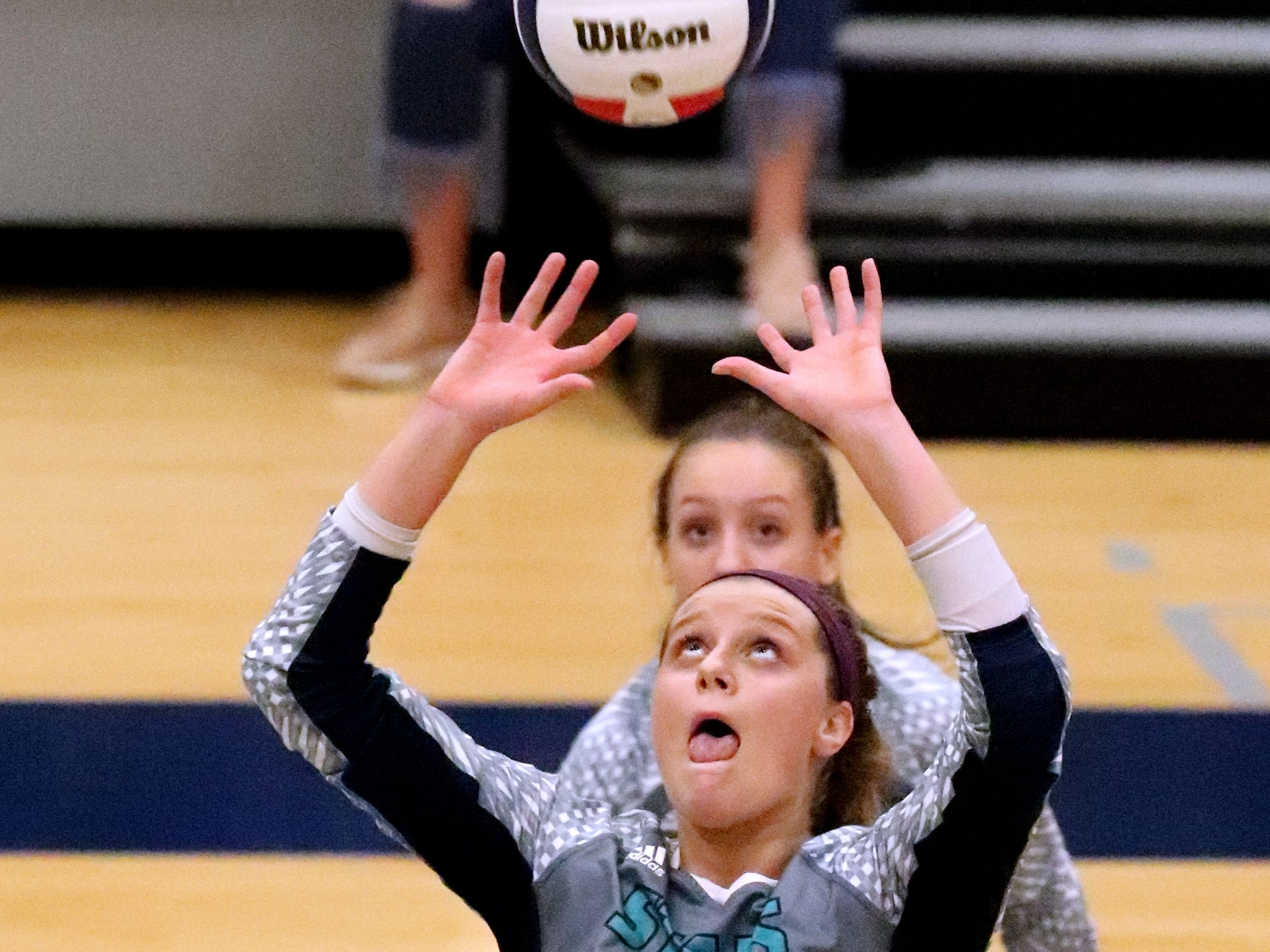 Siegel's Sophia Bossong (25) sets the ball during the Class AAA sectional against Cleveland Thursday, Oct. 11, 2018. Siegel beat Cleveland to advance to the State Championship tournament.