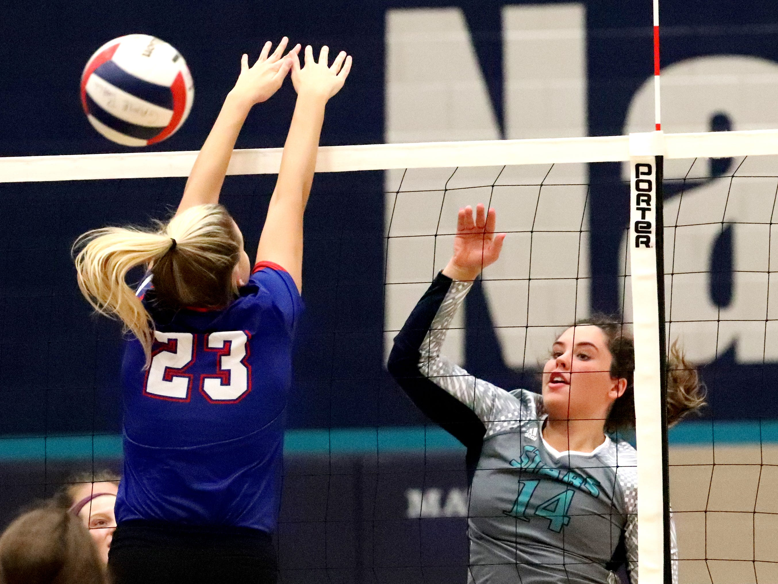Siegel's Sydney Taylor (14) hits the ball over the net during the Class AAA sectional against Cleveland Thursday, Oct. 11, 2018. Siegel beat Cleveland to advance to the State Championship tournament.