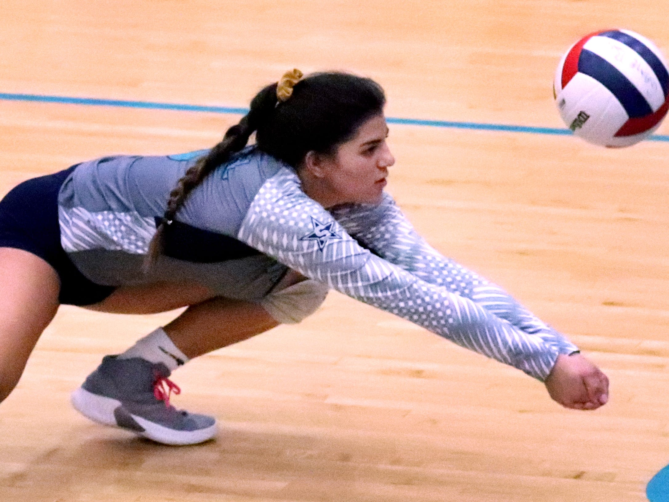 Siegel's June Padilla (6) dives for a dig during the Class AAA sectional against Cleveland Thursday, Oct. 11, 2018. Siegel beat Cleveland to advance to the State Championship tournament.