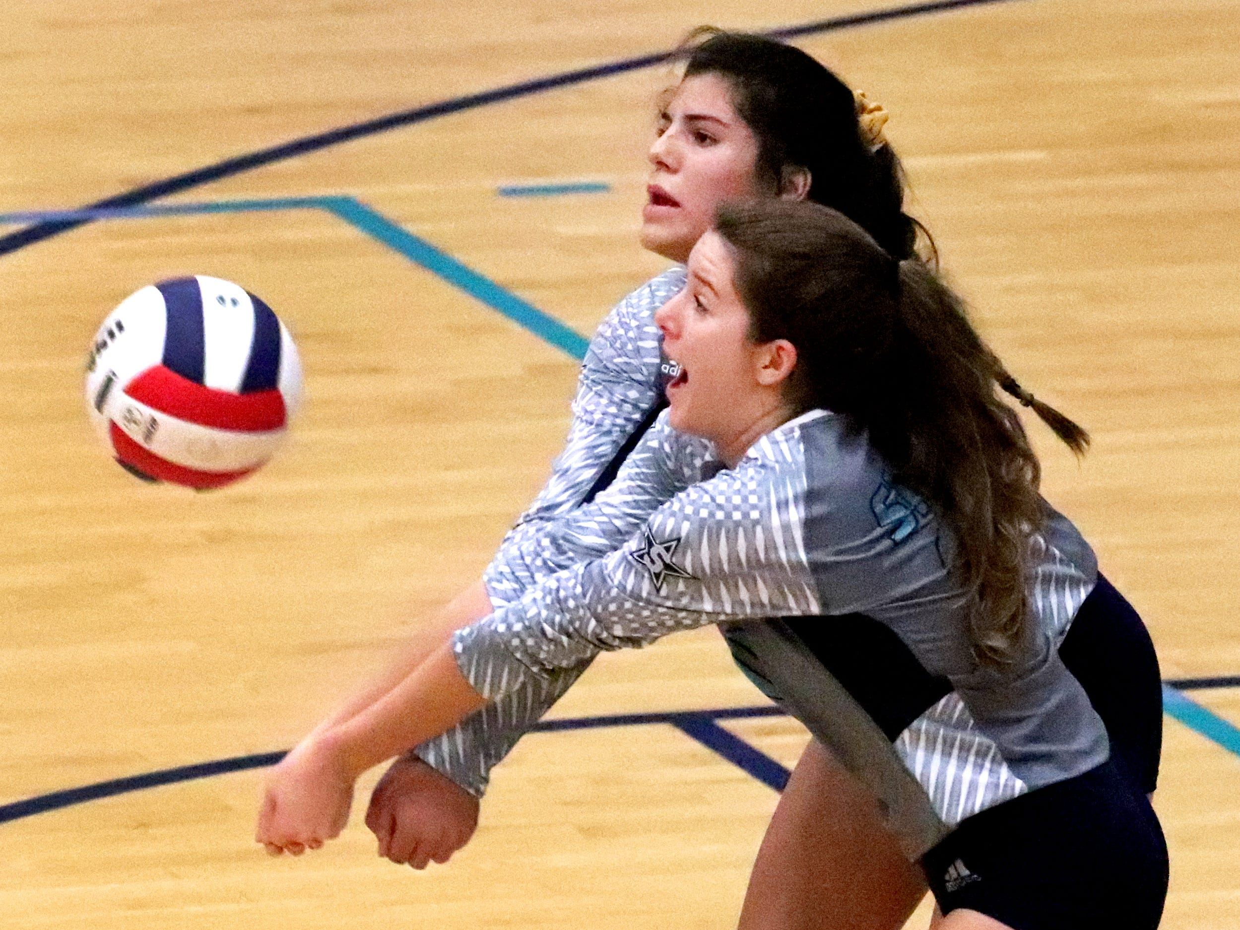 Siegel's June Padilla (6) and Zoe Delk (20) both go to bump the ball during the Class AAA sectional against Cleveland Thursday, Oct. 11, 2018. Siegel beat Cleveland to advance to the State Championship tournament.