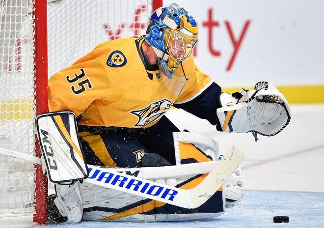 Nashville Predators goaltender Pekka Rinne (35) stops a Winnipeg Jets shot during the second period at Bridgestone Arena in Nashville, Tenn., Thursday, Oct. 11, 2018.