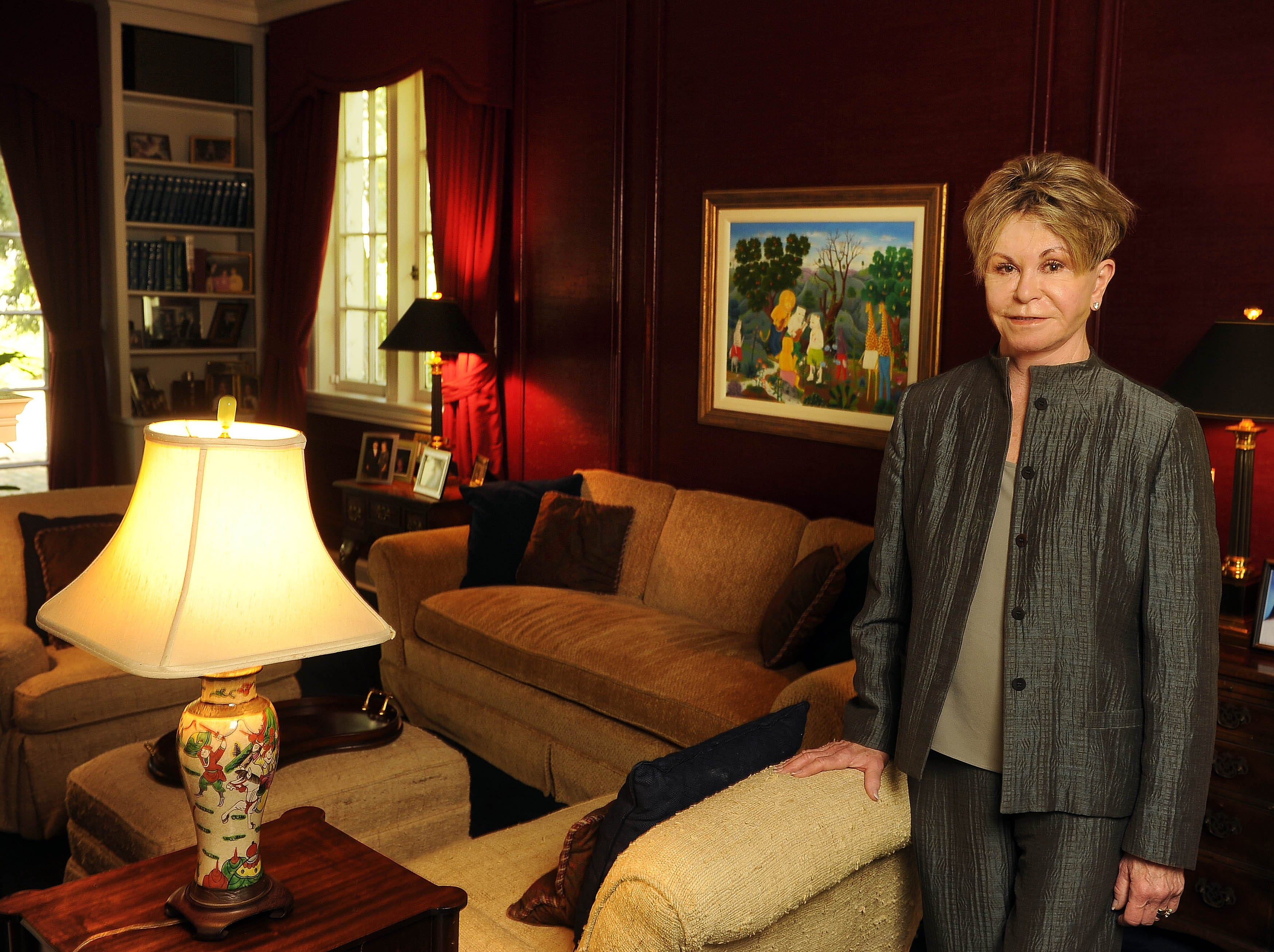 Colleen Conway-Welch poses in the sitting room in her home April 22, 2013.