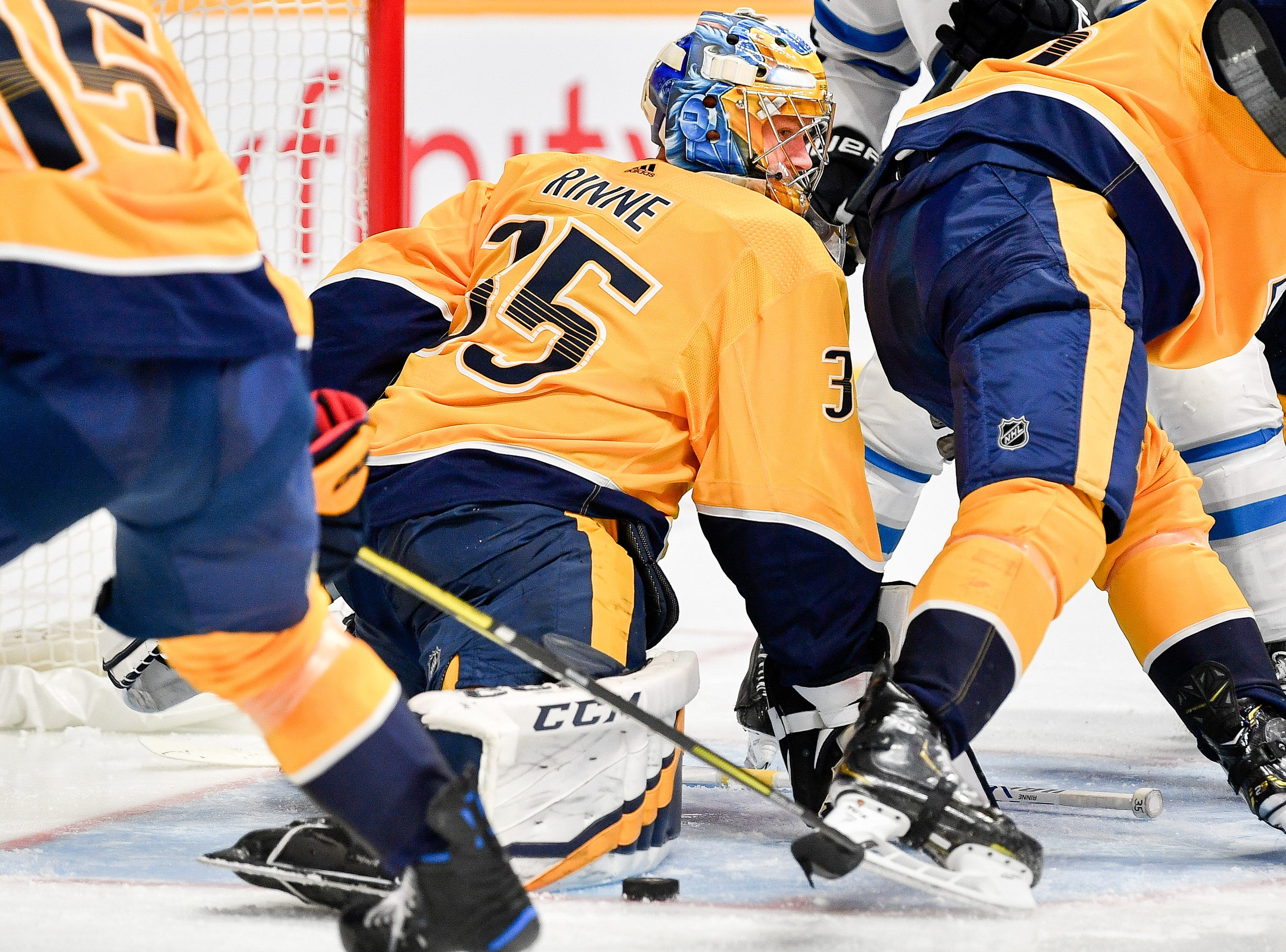 Nashville Predators goaltender Pekka Rinne (35) looks for the puck against the Winnipeg Jets during the second period at Bridgestone Arena in Nashville, Tenn., Thursday, Oct. 11, 2018.