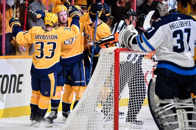 Nashville Predators center Ryan Johansen (92) reacts after scoring past Winnipeg Jets goaltender Connor Hellebuyck (37) during the third period at Bridgestone Arena in Nashville, Tenn., Thursday, Oct. 11, 2018.