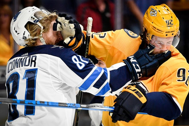 Winnipeg Jets left wing Kyle Connor (81) fights Nashville Predators center Ryan Johansen (92) during the second period at Bridgestone Arena in Nashville, Tenn., Thursday, Oct. 11, 2018.