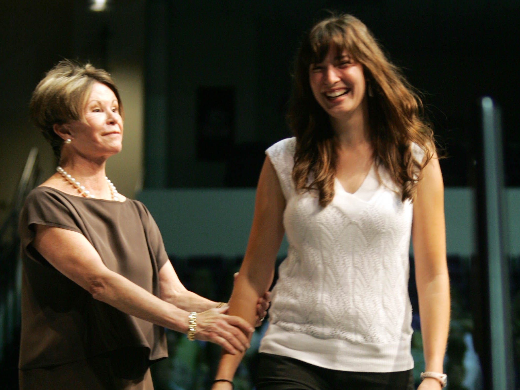 Vanderbilt University School of Nursing Dean and Professor Colleen Conway-Welch, left, congratulates student Amy Morton as she walks across the stage during Vanderbilt University School of Nursing's pinning ceremony at Belmont University's Curb Event Center in Nashville, Tenn., Sunday, August 5, 2007.