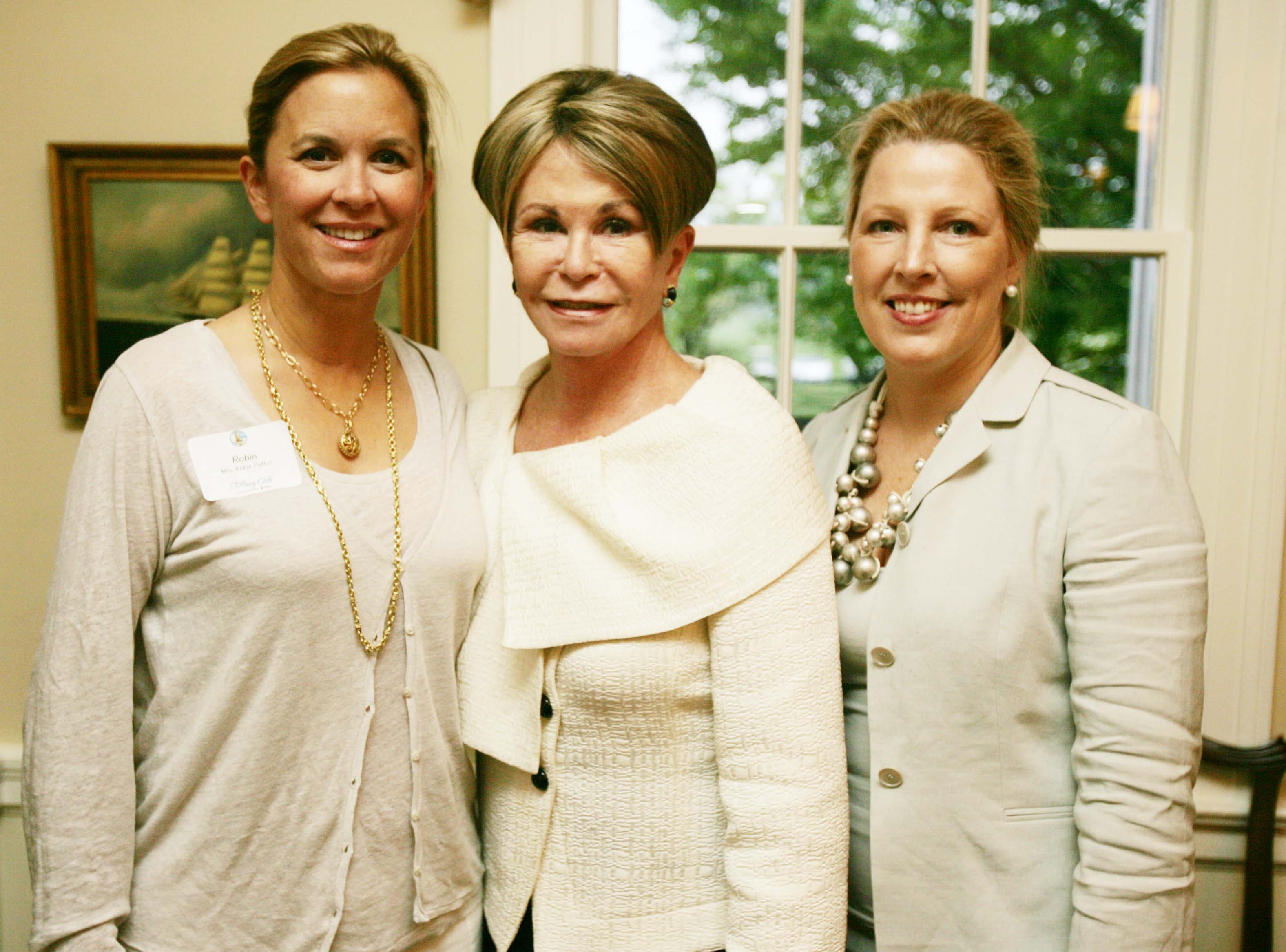 Robin Patton (left), Colleen Conway-Welch and Betsy Willis at the Red Cross Tiffany Circle cocktail dinner in Franklin , Tenn., Thursday, April 22, 2010.