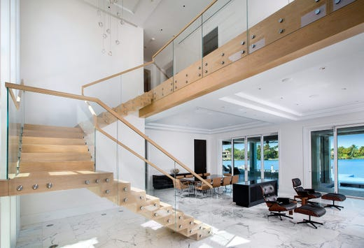 This contemporary Port Royal home located at 500 Admiralty Parade spans 10,000 square feet and is for sale for nearly $20 million. It features a floating white oak staircase and marble floors.