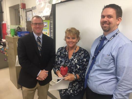 Granville Superintendent Jeff Brown, award-winner Cathy Bero and Granville Elementary School Principal Travis Morris at Friday's award presentation.
