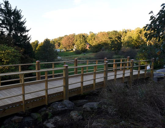 A new footbridge being built along one of the trails near the visitor center at Dawes Arboretum.