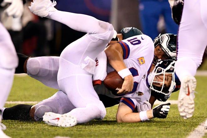 Philadelphia Eagles defensive tackle Destiny Vaeao (97) sacks New York Giants quarterback Eli Manning (10) in the first half. The New York Giants face the Philadelphia Eagles on Thursday, Oct. 11, 2018, in East Rutherford.