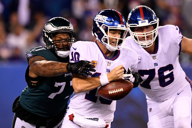 Philadelphia Eagles defensive end Michael Bennett (77) sacks New York Giants quarterback Eli Manning (10) as Nate Solder (76) looks on in the first half. The New York Giants face the Philadelphia Eagles on Thursday, Oct. 11, 2018, in East Rutherford.