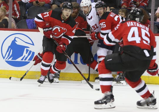 The puck is shown by the stick of John Quenneville, of the Devils, during the third period. Thursday, October 11, 2018
