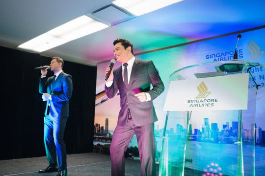 Singers perform in Singapore Changi Airport for Singapore Airlines inaugural longest commercial flight.