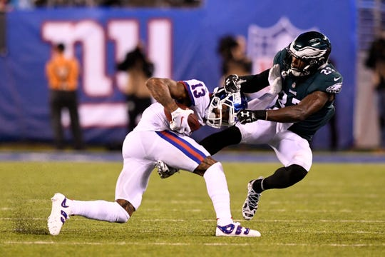 New York Giants wide receiver Odell Beckham Jr. (13) is tackled by Philadelphia Eagles safety Malcolm Jenkins (27) in the second half. The New York Giants face the Philadelphia Eagles on Thursday, Oct. 11, 2018, in East Rutherford.