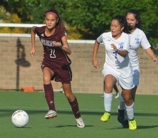 Becton senior Angelyn Ariza trying to break away from Paterson Charter players.