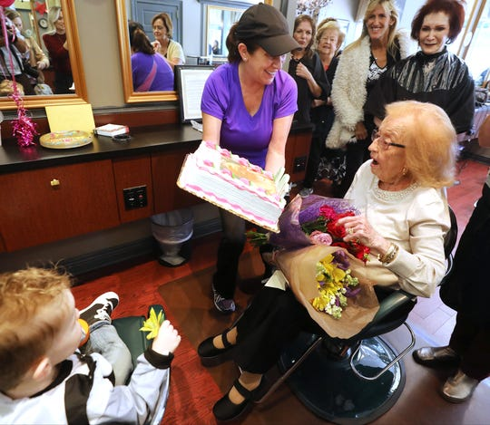 Lorraine Cappio of Ramsey is the receptionist at the Allendale Hair Salon and presents Susan with her birthday cake.