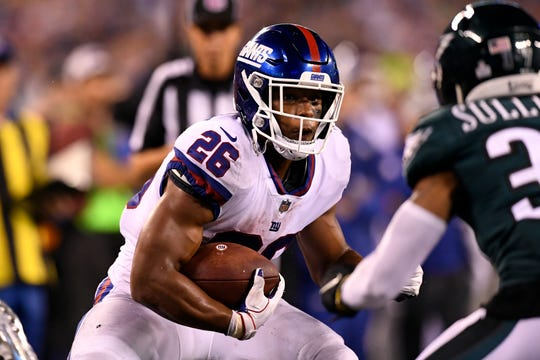 New York Giants running back Saquon Barkley (26) rushes in the second half. The New York Giants face the Philadelphia Eagles on Thursday, Oct. 11, 2018, in East Rutherford.