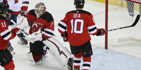 Keith Kinkaid catches the puck with his right arm. Thursday, October 11, 2018
