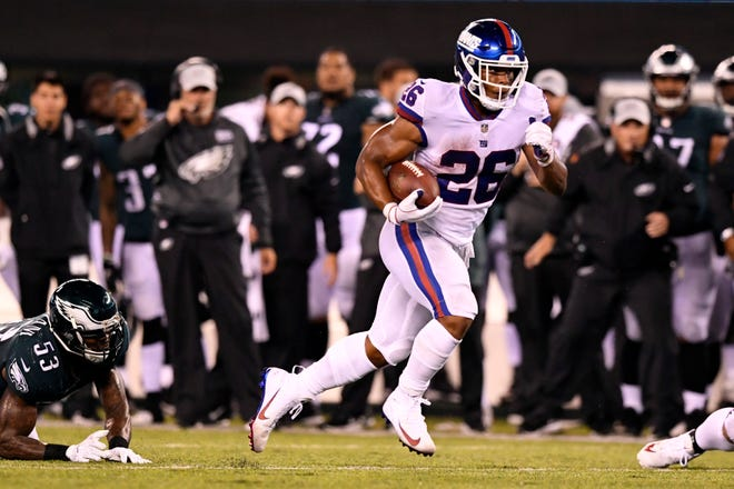 New York Giants running back Saquon Barkley (26) rushes in the first half. The New York Giants face the Philadelphia Eagles on Thursday, Oct. 11, 2018, in East Rutherford.