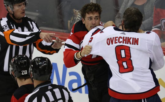 Miles Wood, of the Devils, and Alex Ovechkin, of the Capitals, get into a fight in the first period. Thursday, October 11, 2018