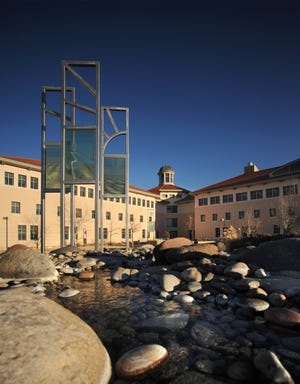 Skeen Hall and the adjacent rock garden and fountain at New Mexico State University.