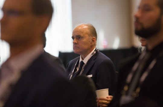 Brian Barnett, founder and CEO of Solstar Space Company, sits in the audience at the International Symposium for Personal and Commercial Spaceflight, Thursday October 11, 2018.