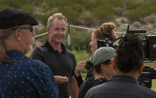 "Actor Billy Boyd talks with crew members between takes while filming ""Walking with Herb"" at Red Hawk Golf Club, Thursday October 11, 2018."