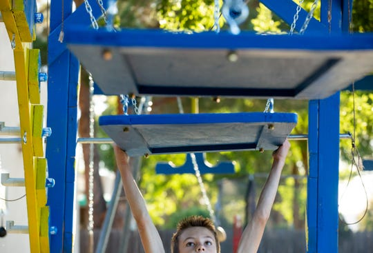"""Miles Odom, 10, of Las Cruces, trains at his home obstacle course on Wednesday, October 10, 2018. Odom is known as the, """"Barefoot Warrior"""" when he is participating as a contestant on America Ninja Warrior Jr. The season premiere is scheduled to air on television Saturday."""