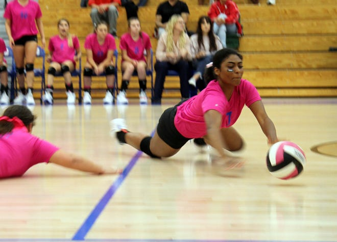 Destiny Young dives for a ball during Thursday's match against Roswell.