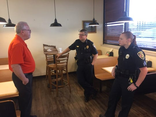 (From left)-Ron Sponagel, manager of Fenn's Country Market in Artesia visits with Artesia Police Chief Kirk Roberts and Artesia Police Sgt. Chantel Longway Friday during Coffee and Donuts with a Cop. Roberts said the Artesia Police Department likes to go to different places monthly to meet with the community.