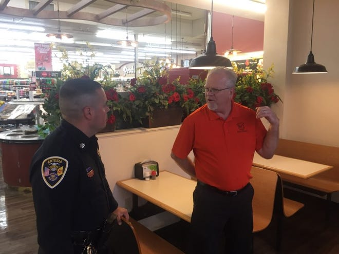 Artesia Police Commander Pete Quinones visits with Ron Sponagel, manager of Fenn's Country Market in Artesia Friday during Coffee and Donuts with a Cop.  The department conducts the monthly event to find out concerns of Artesia residents.