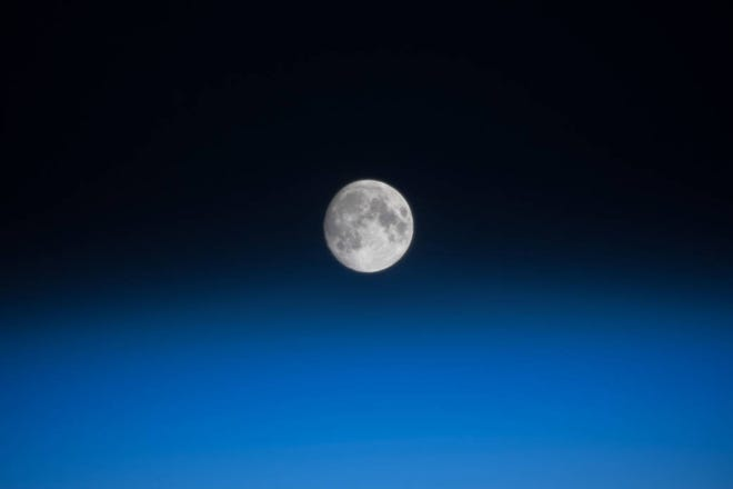 A waxing gibbous moon was pictured above the Earth's limb as the International Space Station orbited over the southern Indian Ocean just southwest of the African continent.