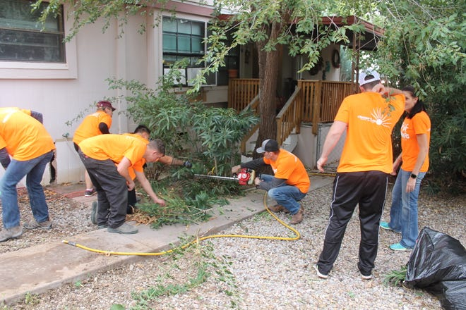 More than 400 civilian and Air Force volunteers signed up for Thrive's annual Day of Caring to do yard work and light maintenance for Otero county residents unable to do the work themselves.