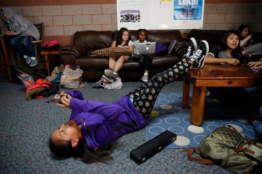 Krystal Tso, 11, relaxes inside the Teen Zone Frida at the Boys & Girls Clubs of Farmington.