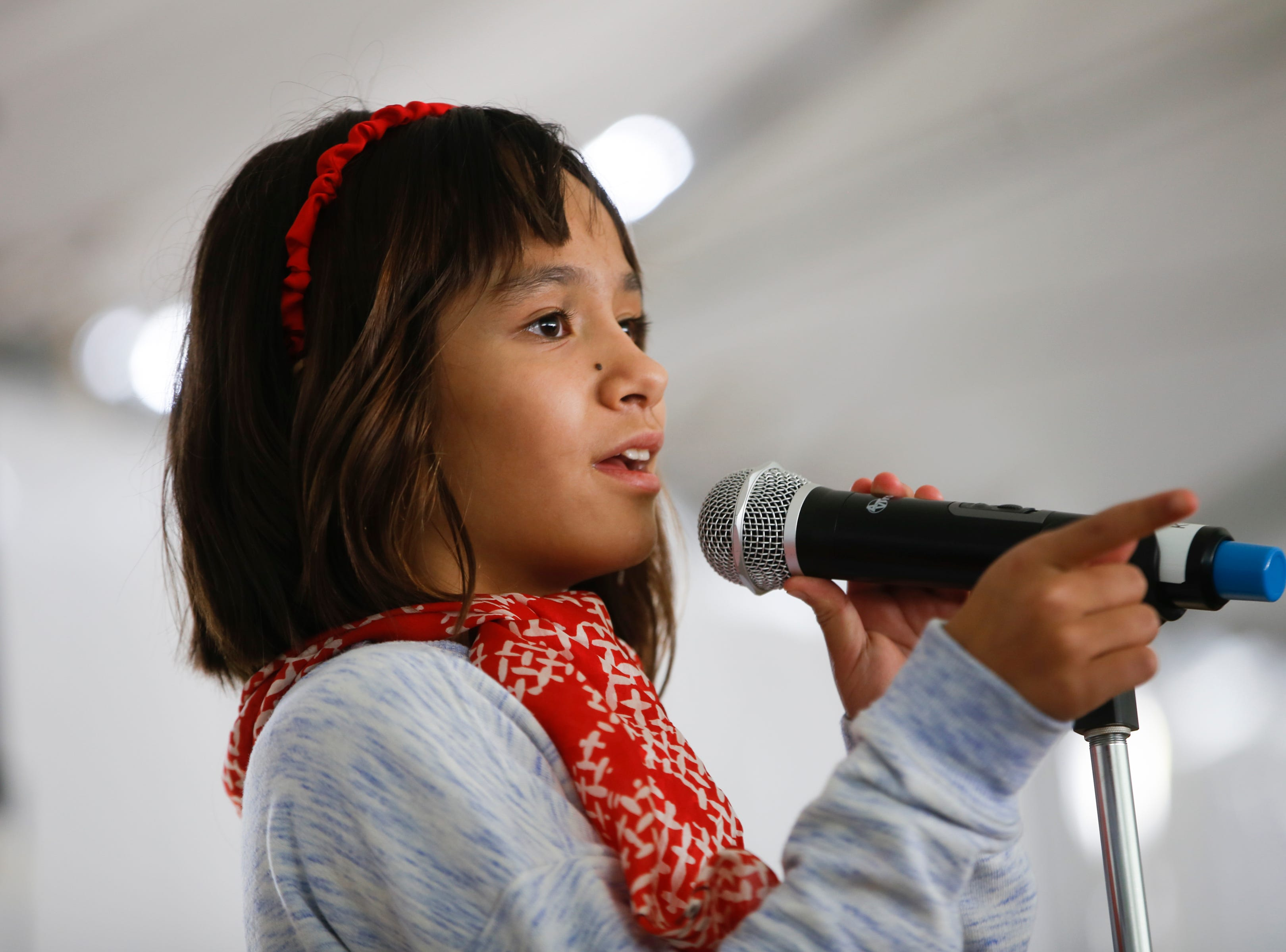Josephine Sheesley, a student from Ladera del Norte Elementary, tells a story, Friday, Oct. 12, 2018 during the Four Corners Storytelling Festival at Berg Park in Farmington.