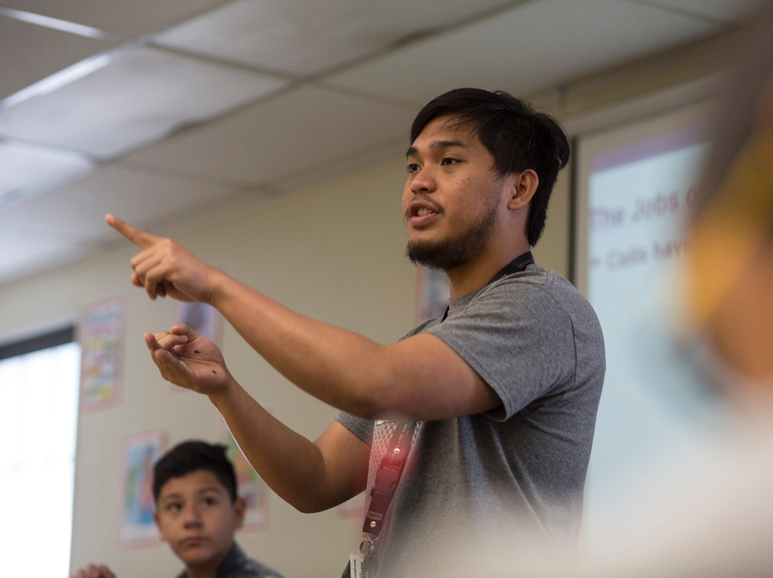 "John Perales instructs his seventh grade biology class at Heizer Middle School in Hobbs. Perales was recruited to teach in the United States on a J-1 ""cultural exchange"" visa that is temporary, paid by the teacher and cannot be easily parlayed into permanent residency."