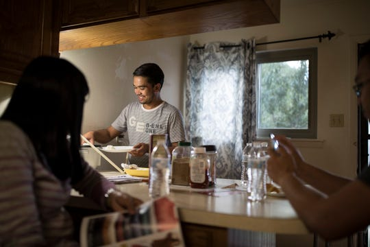 Ronell Mangilit prepares his dinner as he takes turns with his three housemates. Many of the Filipino teachers must share housing as some are burdened with monthly debt payments to recruiters whose fees are anywhere from $5000-$15,000 not including extra expenses that aren't calculated for.