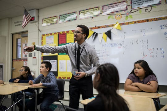 "Filipino teacher Ronell Mangilit instructs the largest of his sixth grade math classes at Heizer Middle School in Hobbs on Oct. 4. ""Mr. M,"" as the students refer to him, is one of 39 Filipino teachers Hobbs Municipal Schools has hired to fill open teaching positions."